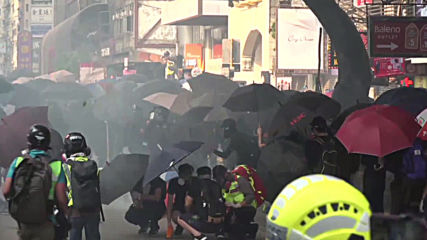 Hong Kong: Molotovs hurled at police station on anti-govt march