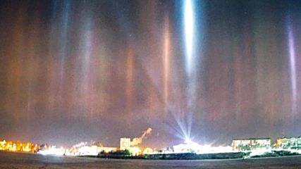 Multi-coloured light pillars illuminate the skies over Nizhny Tagil *STILLS*