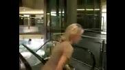 Lady Spins On An Escalator