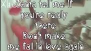Ariana Grande- Santa Tell Me ( Lyrics Video)