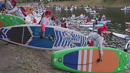 Watercolour! Hundreds of costumed paddleboarders compete in St Petersburg SUP festival