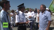 Cyprus: Protesters march to RAF base after missiles fall off plane