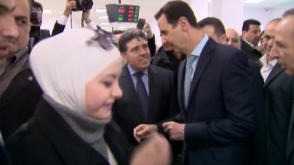 Syria: Assad makes rare appearance at Damascus ceremony for social housing