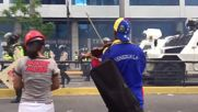 Venezuela: There will always be critics - police teargas protester playing violin in Caracas