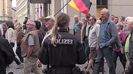 Germany: Pegida holds rally as Merkel makes Dresden visit