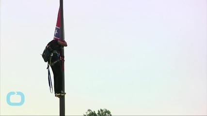 Activist Removes Confederate Flag at South Carolina Capitol