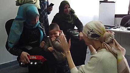 Syria: Asma Assad donates hearing aid to deaf child