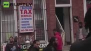 Димящи коли и обрани магазини след протестите в Балтимор