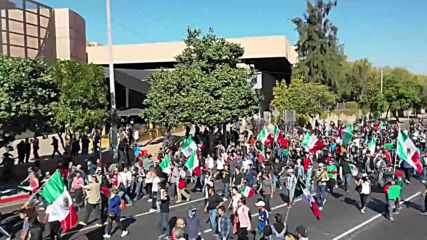 Mexico: Drone captures anti-migrant protesters clash with police in Tijuana