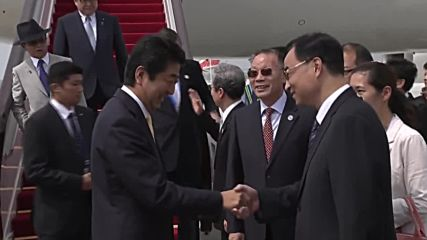 China: Abe greeted by Chinese delegation ahead of G20