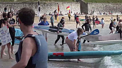 UK: Hundreds urge G7 leaders to protect ocean at Falmouth 'paddle out' protest