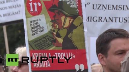 Latvia: Anti-refugee demonstrators march through Riga's streets