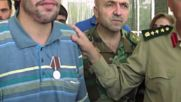 Syria: Russian military honours wounded Syrian soldier, delivers humanitarian aid