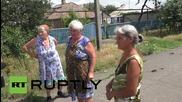 Ukraine: OSCE observers inspect shell-damaged village in Donetsk