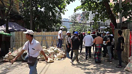 Myanmar: Tear gas flies as anti-coup protests continue in Yangon after dozens killed