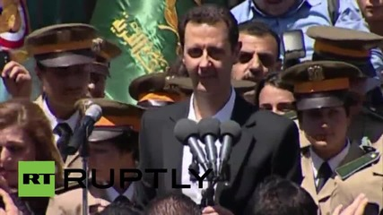 Syria: Assad greeted by crowds on Martyr's Day visit to Damascus school