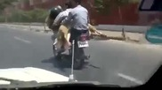 Така се возят двама човека и две овце на мотор !