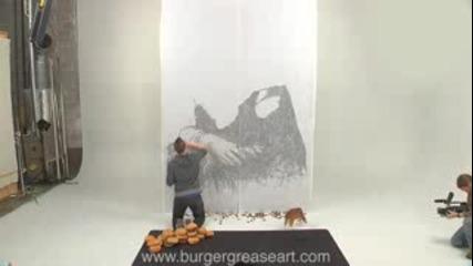 Момче рисува картинка със угризки от хамбургер