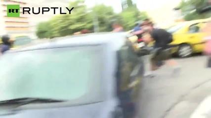 Greek FinMin Varoufakis Motorbikes Over to Brief PM Tsipras