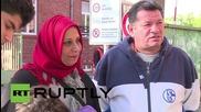 Германия: Плачещият мъж носещ на ръце дъщеря си от разпространената снимка пристигна в Берлин