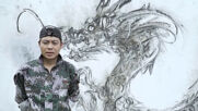 Chinese artist creates wall paintings using burning charcoal