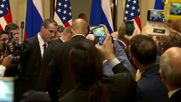 Finland: Protester removed from Putin-Trump press conference
