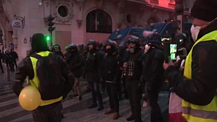France: Tear gas and water cannons as 'Yellow Vests' return to Paris