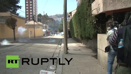 Bolivia: Protesting miners blast door off govt building, face off against riot police