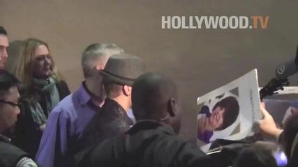 Justin Bieber and Ashton Kutcher sign autographs at Jimmy Kimmel Live