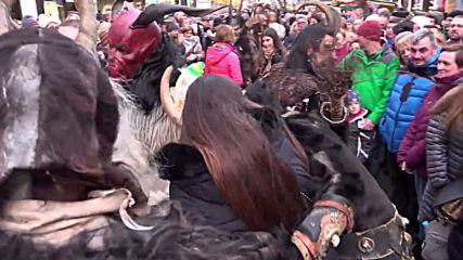 Folkloric Krampus pester Munich Christmas market goers at annual run