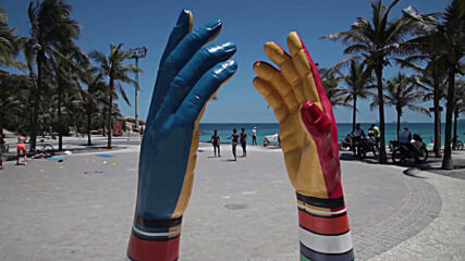 Giant hand sculptures on Rio beaches depict social distancing efforts