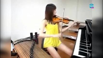 Удивително! това момиче свири едновременно на три органа