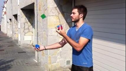 Мъж подрежда кубчето на рубик докато жонглира