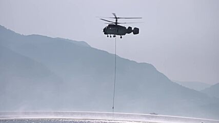 Turkey: Helicopters dump bay water on Marmaris fires as onlookers watch from beaches