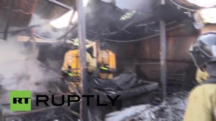 Ukraine: Shelled Donetsk market left in smouldering ruins after huge blaze