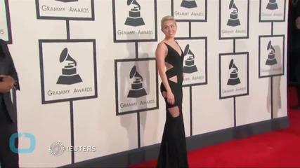 Miley Cyrus Raises $69,000 Auctioning Caitlyn Jenner Artwork