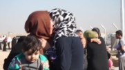 Iraq: Women ditch burqas as they arrive at IDP camp after fleeing Mosul