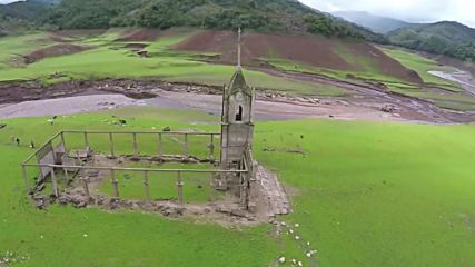 Venezuela: Drone footage shows town's ruins emerged from flood water after 32 years