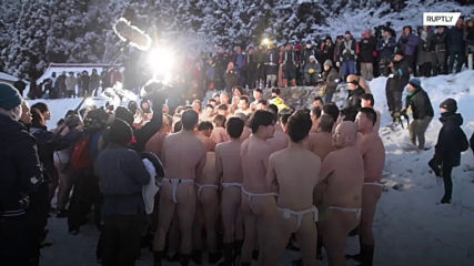Bare bottoms brave the bitter breeze at Japan's Naked Man Festival!