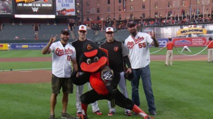 Luke Gallows & Karl Anderson throw out the first pitch for the Baltimore Orioles