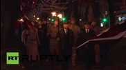 Latvia: Thousands march in torch-lit vigil for War Heroes Remembrance Day