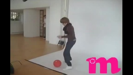 Justin Bieber playing with a basketball at Photoshoot