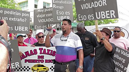 Puerto Rico: Taxi drivers rally against Uber in San Juan
