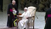 Holy See: Child climbs up to podium, greets Pope Francis, and gets a zucchetto hat