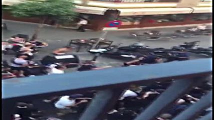 Spain: Lyon ultras clash with police in Seville before Champions League match