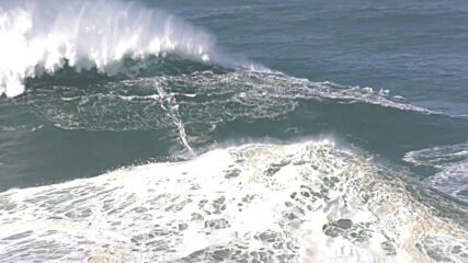 Portugal: Surfers catch massive waves in Nazare after hurricane Episilon stirs up the Atlantic