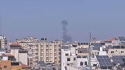 State of Palestine: Smoke from rooftops in Gaza Strip as airstrikes continue
