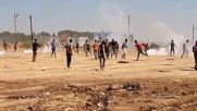 Syria: Kobani protesters flee from tear gas as Turks build border wall