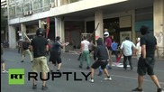 Greece: Riot police clash with far-left protesters in Athens