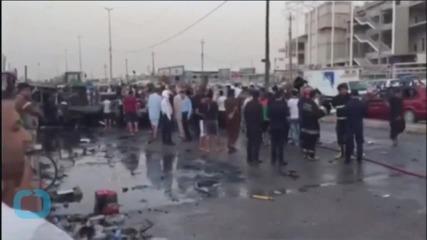 Attacks Around Iraq's Capital Kill 14, Officials Say